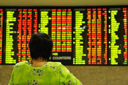 Asian woman watching stock market index