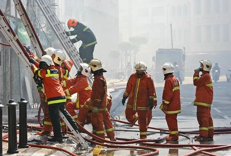 Firemen at Work Stock Photo
