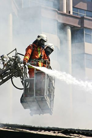 conflagration: Firemen at Work Stock Photo