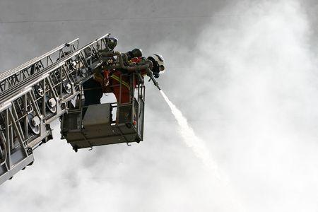 Firemen at Work Stock Photo