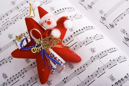 Santa Puppet over music sheet Stock Photo