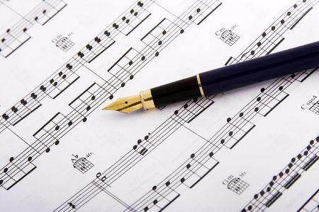 Fountain pen over music sheet photo