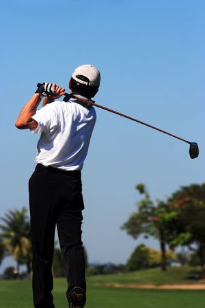 Golfer in action Stock Photo