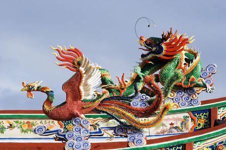 workship: Dragon and phoenix statue.