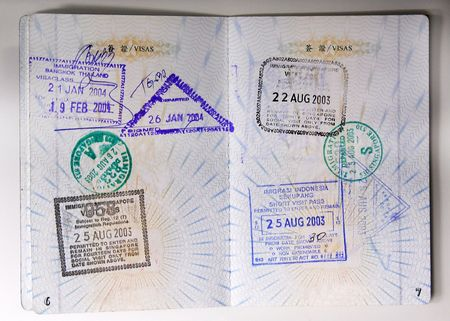 Passport stamps entering Thailand, Singapore and Indonesia. photo