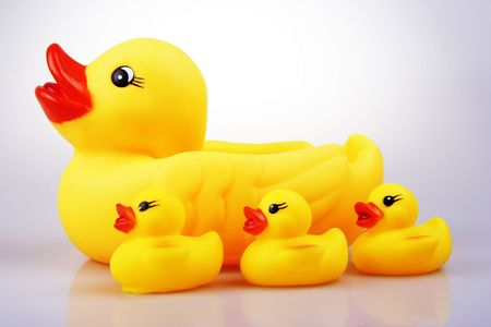Yellowish rubber duck close up.