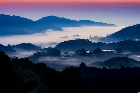 Mountain sunrise with morning fog at Cameron Highland, Malaysia. Stock Photo