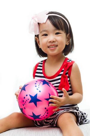 innocent girl: Asian Chinese Girl Holding Ball in white background Stock Photo