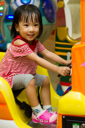 playcentre: Happy Asian Chinese girl at indoor playground Stock Photo