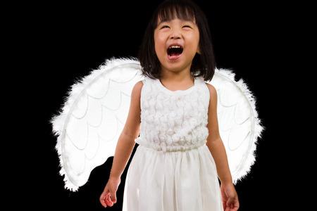 asian angel: Asian Chinese Little Angel in black background studio shot. Stock Photo