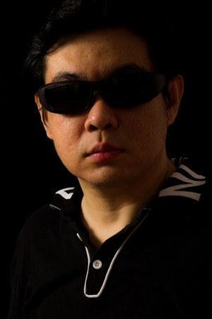 studio shots: Asian Chinese Guy Portrait in dark background studio shots.