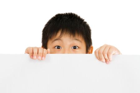 アジア中国小さな少年保持空白のホワイト ボード