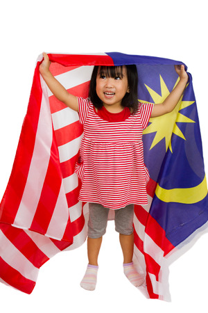 female child: Asian chinese child with Malaysia Flag in isolated white background. Stock Photo