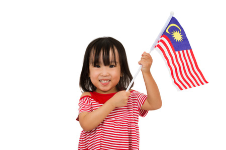 Asian chinese child with Malaysia Flag in isolated white background. Stock Photo