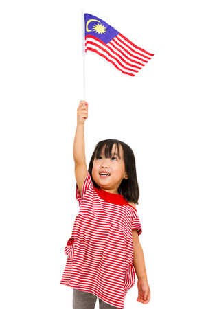 Asian chinese child with Malaysia Flag in isolated white background. 版權商用圖片