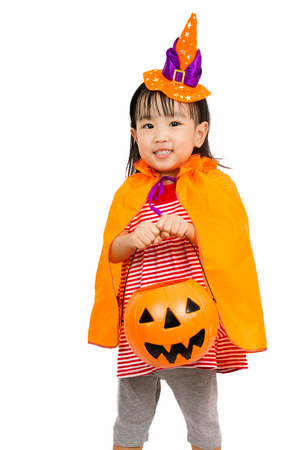 trick or treat: Asian Chinese Little girl celebrate Halloween studio shot.