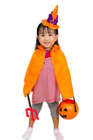 treats: Asian Chinese Little girl celebrate Halloween studio shot.