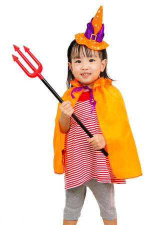 Asian Chinese Little girl celebrate Halloween studio shot.