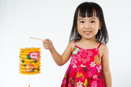 Chinese children holding latern celebrate mid-autumn festival (moon cake festival) in plain white isolated background.