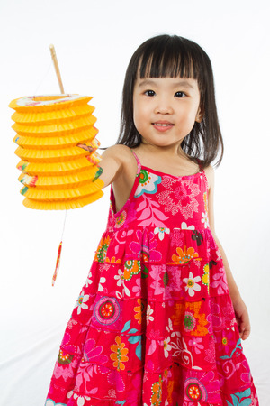moon cake festival: Chinese children holding latern celebrate mid-autumn festival (moon cake festival) in plain white isolated background.