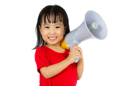 white girl: Portrait of a young little Chinese girl holding a megaphone in isolated white background.