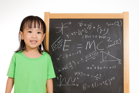 mc2: Asian Chinese children againts blackboard or chalkboard with formulas in plain isolated white background.