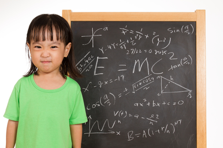 achiever: Asian Chinese children againts blackboard or chalkboard with formulas in plain isolated white background.