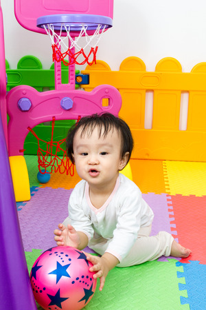 boy basketball: Asian Chinese little boy playing basketball at indoor colourful playground Stock Photo