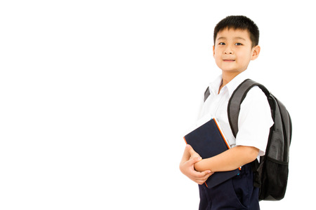 boy smiling: Asian Little School Boy Holding Books with Backpack on White Background