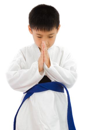 Asian Little Karate Boy in White Kimono on White Background