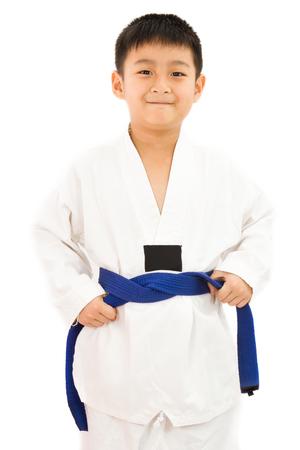 asian children: Asian Little Karate Boy in White Kimono on White Background