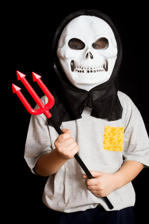 trident: A Man Wearing Skull Mask With Trident in Isolated Black Background.