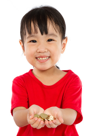 asian coins: Asian Little Girl Holding Coins for Saving isloated on White Background
