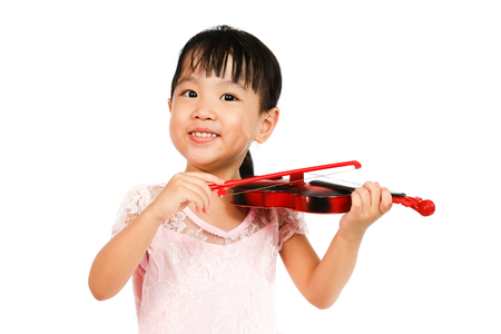Chinese Little Girl Playing Violin on a white background Stock Photo