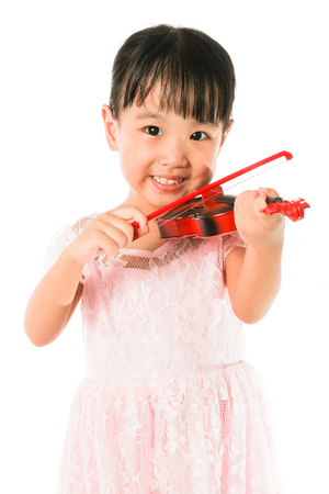 asia children: Chinese Little Girl Playing Violin on a white background Stock Photo