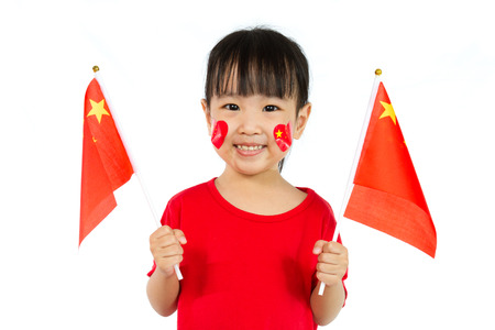 Asian Little Chinese Girl Holding China Flag Isolated on White Background. Stock Photo