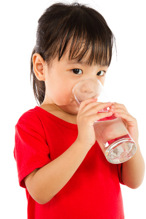 Asian Little Chinese Girl Holding a cup of Water isolated on White Background 版權商用圖片