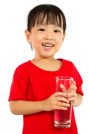 small girl: Asian Little Chinese Girl Holding a cup of Water isolated on White Background Stock Photo