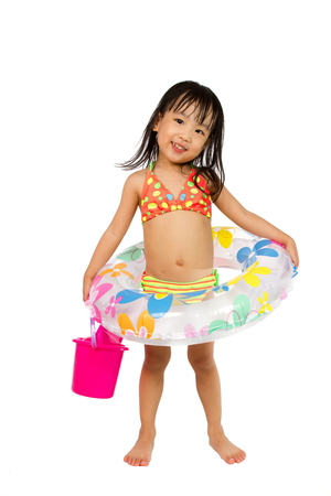girls in bikini: Asian Little Chinese Girl Playing with Swimming Ring isolated on White Background.