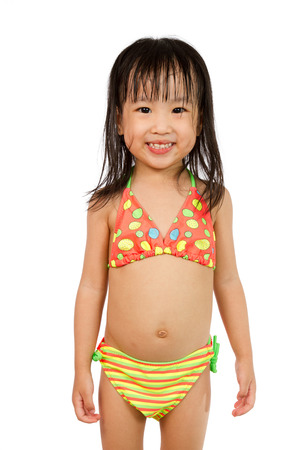 healthy girl: Asian Little Chinese Girl in Swimsuit isolated on White Background.