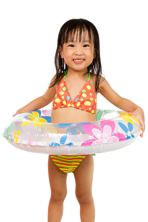 healthy girl: Asian Little Chinese Girl Playing with Swimming Ring isolated on White Background.