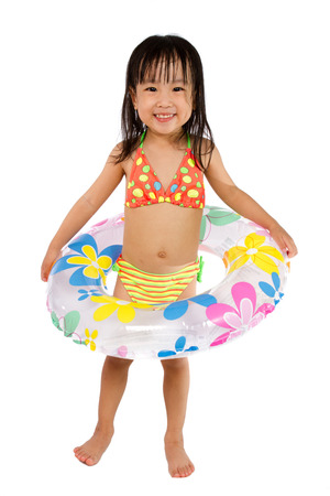 child bath: Asian Little Chinese Girl Playing with Swimming Ring isolated on White Background.