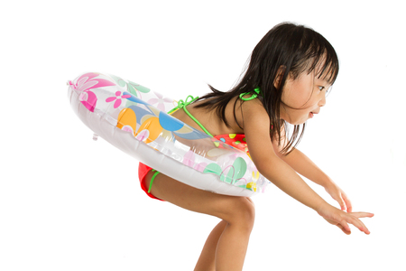 girl sport: Asian Little Chinese Girl Playing with Swimming Ring isolated on White Background.