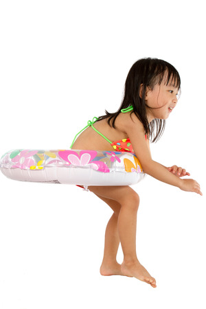 little girl bath: Asian Little Chinese Girl Playing with Swimming Ring isolated on White Background.