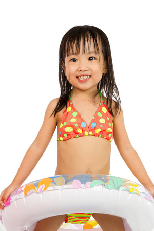 cute little girl: Asian Little Chinese Girl Playing with Swimming Ring isolated on White Background.