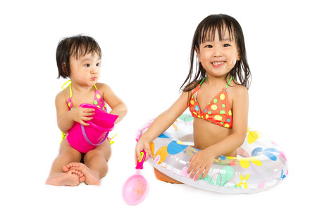 family isolated: Asian Little Chinese Girl Playing with Swimming Ring isolated on White Background.