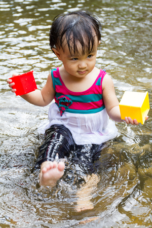 asia children: Asian Little Chinese Girl Playing in Creek in the Forest