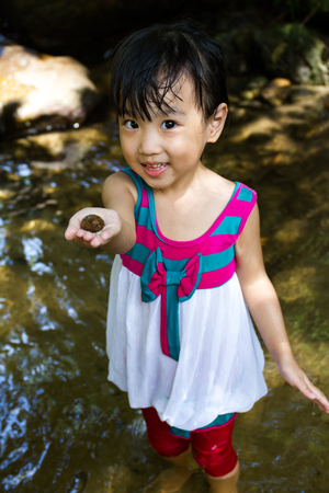 bourne: Asian Little Chinese Girl Playing in Creek in the Forest