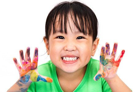 smile child: Asian Little Chinese Girl Playing and Painting isolated on White Background Stock Photo