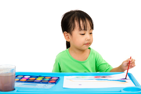 asian children: Asian Little Chinese Girl Painting with Brush at Home Stock Photo